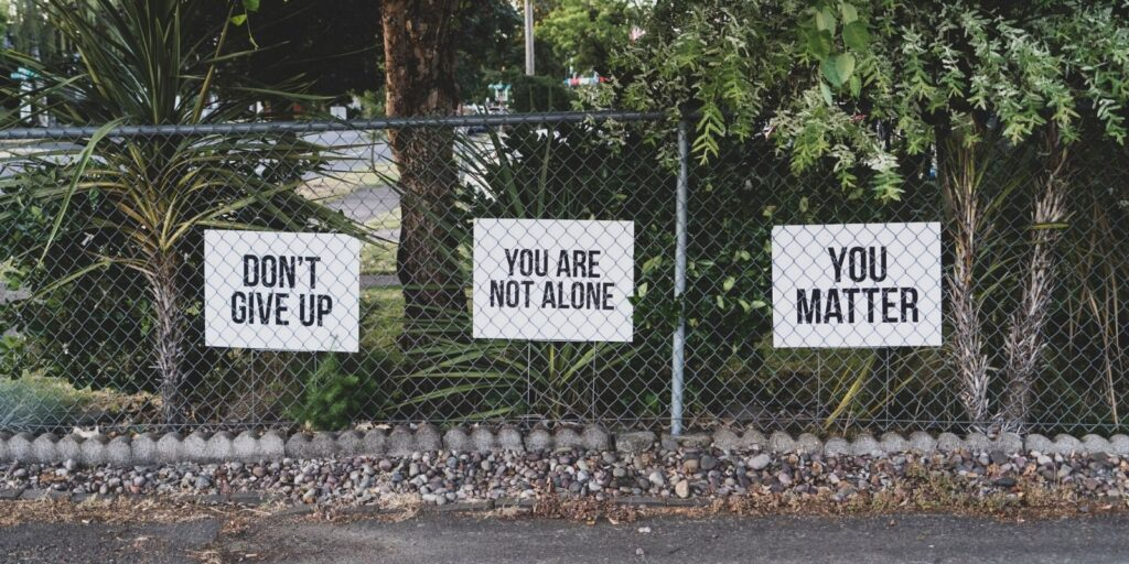Fence with display cards saying You Matter and Don't Give Up