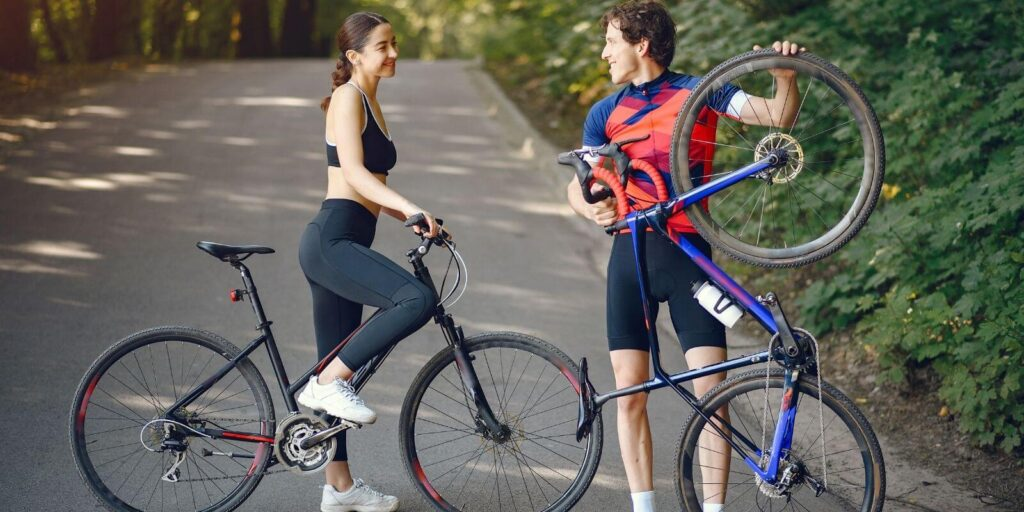 Photo of a young couple enjoying cycling and talking